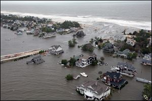 An aerial view of  the damage to the shoreline and the houses in Mantoloking, N.J., following Superstorm Sandy is seen in this October, 2012 photo.