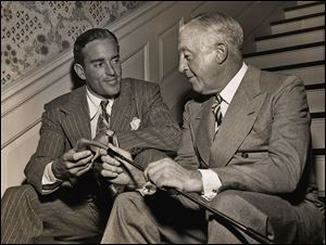 Frank Stranahan chats with his father, R.A. Stranahan, in 1955. R.A. founded Champion Spark Plug with his brother, Frank D. Stranahan.
