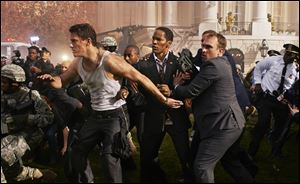 Channing Tatum, left, and Jamie Foxx, center, star in Columbia Pictures' &quo