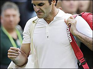 Roger Federer walks off the court after losing to Sergiy Stakhovsky  6-7 (5), 7-6 (5), 7-5, 7-6 (5) in the second round.