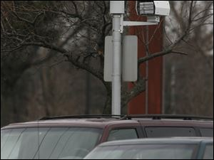 Toledo police officials say the city's traffic cameras, such as this one, have reduced d
