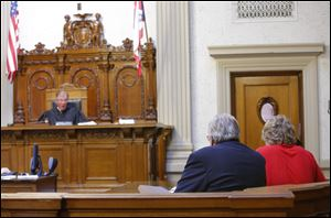 Judge Michael A. Borer speaks to Michael Aaron Fay and his attorney William Kluge in Juvenile Court  in connection to aggravated murder at the Putnam County Courthouse in Ottawa, Ohio, in May.