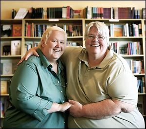 Partners Juliana Jackson, left, and Luann Antoszewski of Toledo embrace at People Called Women bookstore in Sylvania Township.