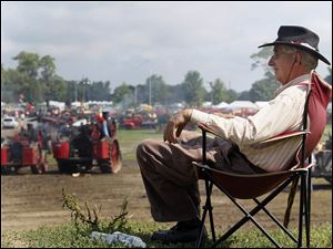 David Pence of Bluffton, Ind., sits on a rise to watch the action.