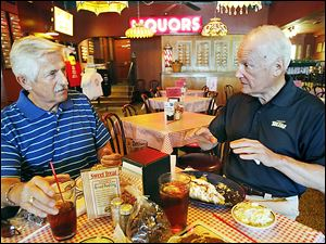 Longtime Toledoans Tom Walton, left, and Carty Finkbeiner talk about the city's past, present, and future — and baseball.