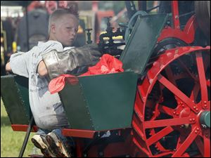 Tennessee resident Ethan Brown, 10, tends to his steam engine.