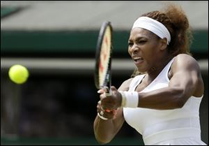 Serena Williams of the United States returns to Caroline Garcia of France during their Women's second round singles match at the All England Lawn Tennis Championships in Wimbledon, London.
