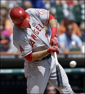 Los Angeles Angels' Mike Trout hits a double against the Detroit Tigers in the third inning of a baseball game in Detroit today.