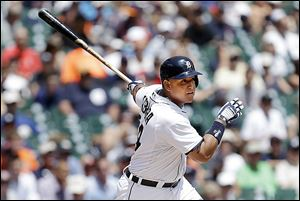 The Tigers' Miguel Cabrera hits a double in the third inning against the Los Angeles Angeles.