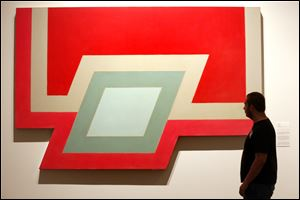 David Buchette, 17, inspects the museum's newly acquired 'Conway I' by Frank Stella.