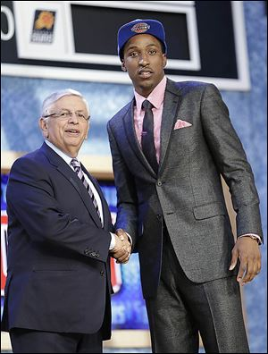 David Stern congratulates Georgia guard Kentavious Caldwell-Pope, who was selected by the Pistons with the No. 8 pick.