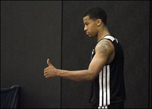 Michigan point guard Trey Burke gives a thumbs up during a pre-draft workout.