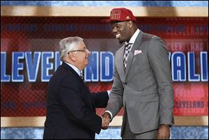 NBA Commissioner David Stern, left, shakes hands with UNLV's Anthony Bennett, who was selected first overall by Cleveland.