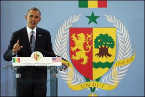 President Obama gestures during a news conference at the Presidential Palace in Dakar, Senegal today.