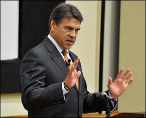 Texas Gov. Rick Perry, seen here in Connecticut last week, vowed today his state would push ahead to approve a ban on abortion after 20 weeks of pregnancy
