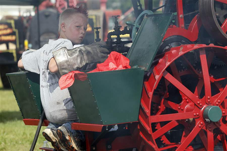 Tennessee-resident-Ethan-Brown-10-tends-to-his-steam-engine