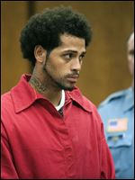 Carlos Ortiz is shown during a hearing in court in Bristol, Conn., today.