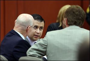 George Zimmerman, center, talks to his defense team during his trial in Seminole circuit court in Sanford, Fla. Thursday, June 27, 2013. Zimmerman has been charged with second-degree murder for the 2012 shooting death of Trayvon Martin.