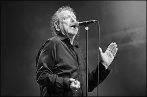 Former Led Zeppelin lead singer Robert Plant performs on stage with his new band The Sensational Space Shifters at Bluesfest Byron Bay 2013 in Australia.