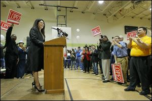 Anita Lopez speaks during an election rally at Aurora Gonzalez Community Center.