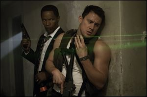 Jamie Foxx, left, and Channing Tatum in a scene from