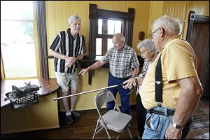Louisa Strock points to the Oliver Standard Visible typewriter that her father, John S. Mires, used at the Liberty Press newspaper in the early 1900s, to sesquicentennial committeemen, from left, Roger Fisher, John Eckenrode, and John Swearingen at Wabash Depot  in Henry County's Liberty Center.