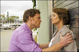 Michael C. Hall as Dexter Morgan, left, and Charlotte Rampling as Dr. Vogel, in a scene from the final season.