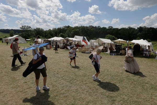 Gettysburg-150th-AnniversarySpectators-go-to-a-reenactment-shop-in-a-tent-city