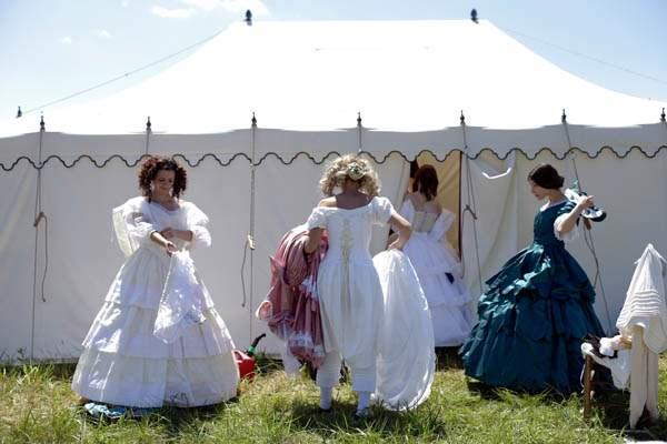 Women-take-off-Civil-War-era-ball-gowns-rev