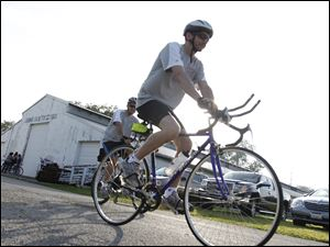A bicyclist heads out for Bike to the Bay ride.