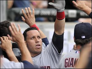 Cleveland Indians' Asdrubal Cabrera celebrates with teammates in the dugout after scoring on a Jason Kipnis double during the second inning.