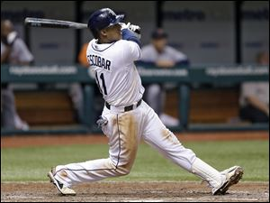 Tampa Bay Rays' Yunel Escobar hits the game-winning RBI single off Detroit Tigers relief pitcher Bruce Rondon.