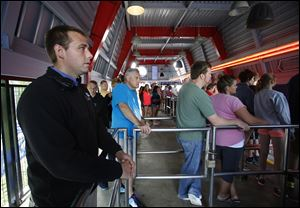 John Hoiden, Department Supervisor for Rides at Cedar Point amusement park in Sandusky, keeps a close watch on things at the Millennium Force ride.