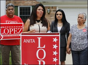 Anita Lopez, Democratic candidate for mayor of Toledo, discusses her personal finances during a news conference in front of her home on Belvedere Drive in Toledo on today. Behind her are friend Lupita Cool, and her mother, Minerva Lopez.