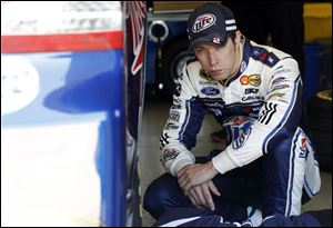 Brad Keselowski sits in the garage between laps during testing at Texas Motor Speedway in Fort Worth,Texas.