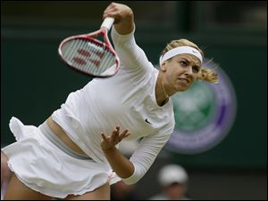 Sabine Lisicki of Germany serves to Serena Williams.