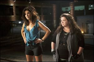 Sandra Bullock, left, stars as FBI Special Agent Sarah Ashburn, and Melissa McCarthy, as Boston Detective Shannon Mullins, in a scene from the film, 'The Heat.'