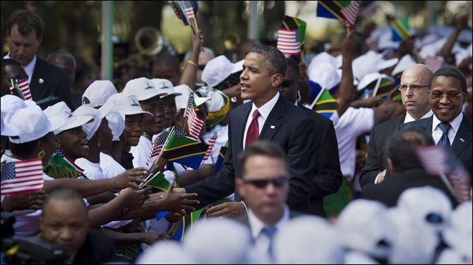 Obama Tanzania crowd President Obama shakes the hands of a line of women stationed to welcome his arrival, accompanied by Tanzanian President Jakaya Kikwete, right, at State House in Dar es Salaam, Tanzania today.