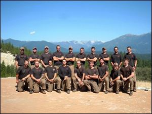 Mmembers of the Granite Mountain Interagency Hotshot Crew from Prescott, Ariz., pose together in this undated photo.