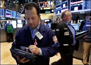 Indexes fall on Wall Street after gains earlier in the day.