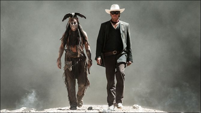 "Johnny Depp, left, as Tonto, and Armie Hammer, as The Lone Ranger, in a scene from the film, ""The Lone Ranger."""