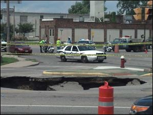 A large sinkhole opened up on Detroit Avenue Wednesday swallowing a vehicle and its driver.