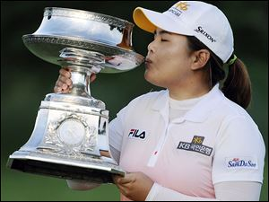Inbee Park kisses the trophy after winning the LPGA Championship tournament this season. It is one of three majors the South Korean has captured in a year that has five majors.
