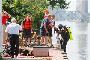 A diver from the Toledo Fire Department finishes a search on the Maumee River.