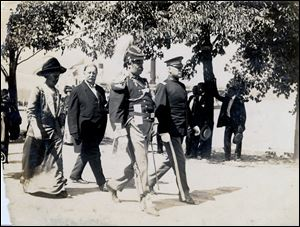 William Howard Taft, in suit, by then a former president, attended the September, 1913, dedication ceremony when the remains of three American and three British officers were buried beneath the rotunda floor.