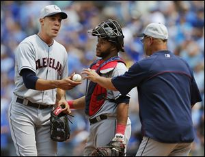 Cleveland Indians starting pitcher Ubaldo Jimenez, left, hands the ball to manager Terry Francona, right, after giving up a grand slam during the sixth inning.