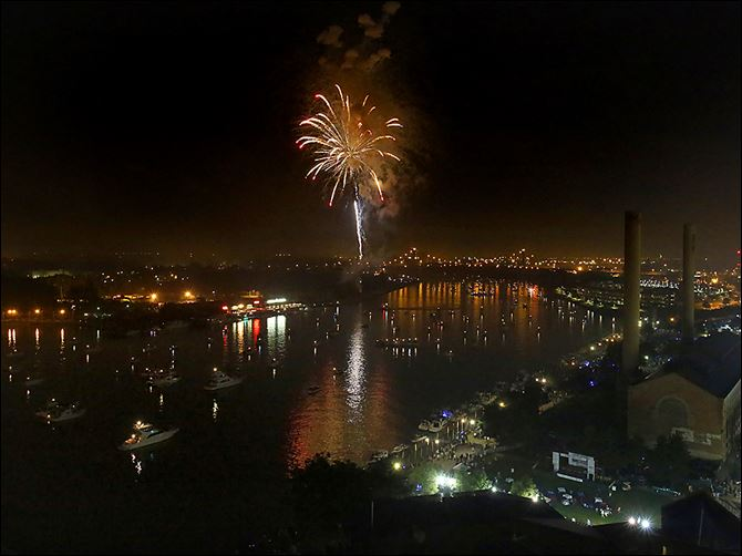 Fireworks explode over the Maumee River on July 4  in downtown Toledo during the Red, White, KABOOM celebration.