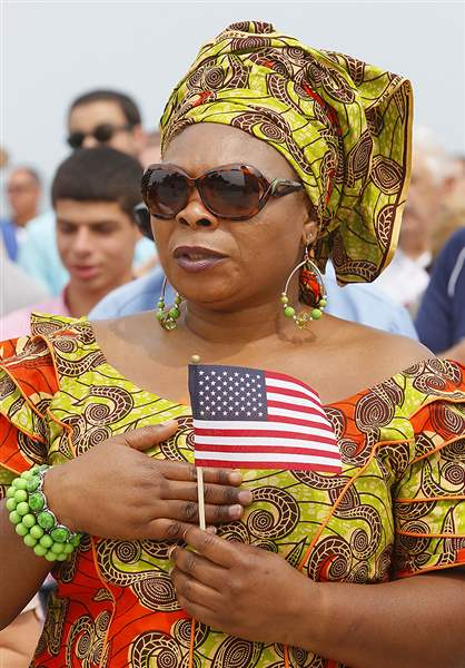 Pammella-Ngefor-of-Sylvania-originally-from-Cameroon-recites-the-Pledge-of-Allegiance-in-a-naturalizatio