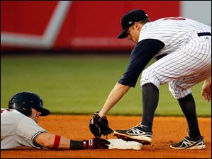 Indianapolis' Matt Hague steals second base against Toledo Mud Hens second baseman Danny Worth in the seventh inning.