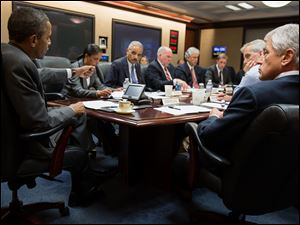 President Obama meeting with members of his national security team to discuss the situation in Egypt in the Situation Room of the White House Wednesday.